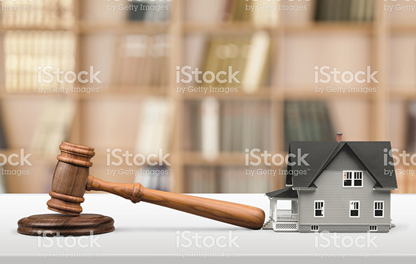 Gavel with a small house